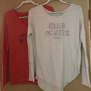 Club Pilates long sleeve shirts. Two.